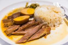 Stewed pork leg on rice. Royalty Free Stock Photography