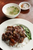 Stewed pork leg on rice with spicy sour sauce and soup Royalty Free Stock Photography