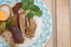 Stewed pork leg on rice Stock Image