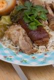 Stewed pork leg on rice Stock Photography