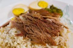 Stewed pork leg on rice. Royalty Free Stock Photos