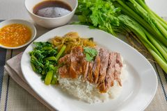 Stewed pork leg on rice. Royalty Free Stock Photo
