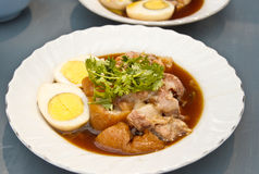 Stewed pork leg served with eggs Stock Images