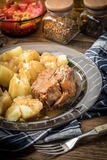 Stewed pork meat served with potatoes Stock Photos