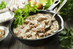 Stewed pork with mustard sauce. Stewed pork with sour cream and mustard sauce stock images