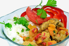 Stewed pork and vegetables. With rice in glass bowl isolated on white stock photos