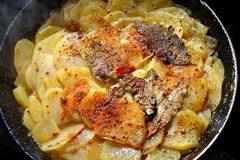 Stewed Potato. Process of cooking stewed potato with bay leaf and spices Stock Photos