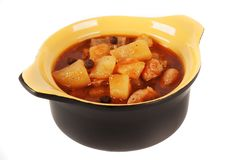Stewed potatoes with meat in a ceramic pot. Stock Photo
