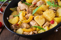 Stewed potatoes with meat and vegetables in a roasting tin. Stock Image