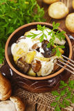 Stewed potatoes with mushrooms and sour cream Royalty Free Stock Photography
