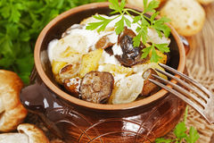 Stewed potatoes with mushrooms and sour cream Royalty Free Stock Images