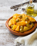 Stewed potatoes with olives and tomato sauce Stock Photos