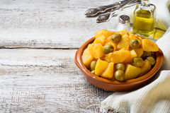 Stewed potatoes with olives and tomato sauce Royalty Free Stock Images