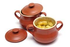 Stewed potatoes at the pot Royalty Free Stock Image