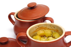Stewed potatoes at the pot Stock Images