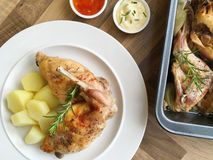 Stewed rabbit served with boiled potatoes and rosemary herb. Top view. Royalty Free Stock Image