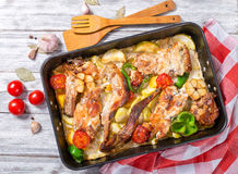 Stewed rabbit with vegetables, traditional maltese cuisine Stock Photo