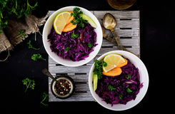 Stewed red cabbage with carrots and celery in a white bowl Stock Photography