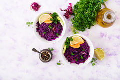 Stewed red cabbage with carrots and celery in a white bowl Stock Photos
