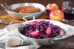 Stewed red cabbage. Garnish for fried sausages. Stewed red cabbage with spices and apples. Garnish for fried sausages Stock Photo