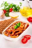 Stewed squid rings with tomato sauce Royalty Free Stock Photo