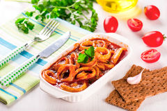 Stewed squid rings with tomato sauce Stock Photo