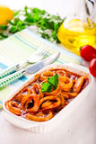 Stewed squid rings with tomato sauce Stock Photos