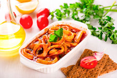 Stewed squid rings with tomato sauce Royalty Free Stock Image