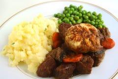 Stewed steak and dumpling dinner Stock Images