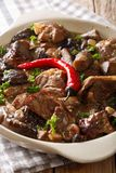 Stewed veal with wild forest mushrooms in a wine sauce close-up. Royalty Free Stock Photography
