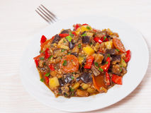 Stewed vegetables. eggplant, peppers, onions, carrots, potatoes. Royalty Free Stock Photo