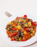 Stewed vegetables. eggplant, peppers, onions, carrots, potatoes. Stock Photography
