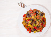Stewed vegetables. eggplant, peppers, onions, carrots, potatoes. Royalty Free Stock Image