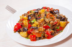 Stewed vegetables. eggplant, peppers, onions, carrots, potatoes. Stock Photo