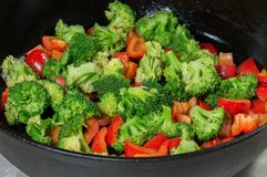 Stewed vegetables, peppers and broccoli in a frying pan. vegetarian cuisine.  Royalty Free Stock Photo