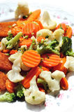 Stewed vegetables on a plate. Stewed carrots, broccoli, cauliflower, on a plate Royalty Free Stock Photo