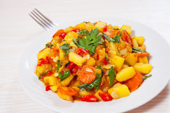 Stewed vegetables. zucchini, peppers, onions, carrots, potatoes. Stock Images