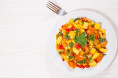 Stewed vegetables. zucchini, peppers, onions, carrots, potatoes. Royalty Free Stock Photography