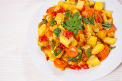 Stewed vegetables. zucchini, peppers, onions, carrots, potatoes. Stock Photos
