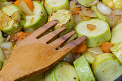 Stewed zucchini and spices. Wooden fork Royalty Free Stock Photography