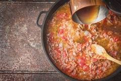 Stewing meat , onion and tomatoes top view Stock Image