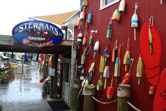 Stewmans Restraunt Fishing Buoy. Downtown Stewmans Restaurant with Fishing Buoys hanging on siding Royalty Free Stock Photography