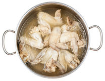 Stewpan with boiled chicken wings isolated Royalty Free Stock Photo