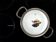 Stewpot on induction cooker Stock Image