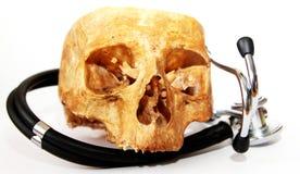 Sthethoscope and human skull Royalty Free Stock Photos
