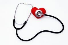Sthetoscope y corazón Foto de archivo libre de regalías