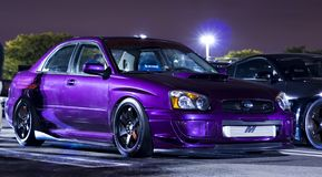 STI modificado para requisitos particulares púrpura metálico de Subaru WRX fotografía de archivo