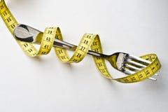 Stia il concetto a dieta. Forcella metallica Fotografia Stock