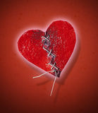Stiched heart. A broken heart tht has been stiched Stock Images