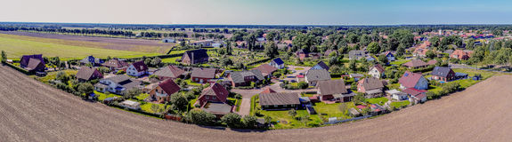 Stiched panorama of a small village near Gifhorn, Germany. Aerial view, horizon in the background Stock Photography
